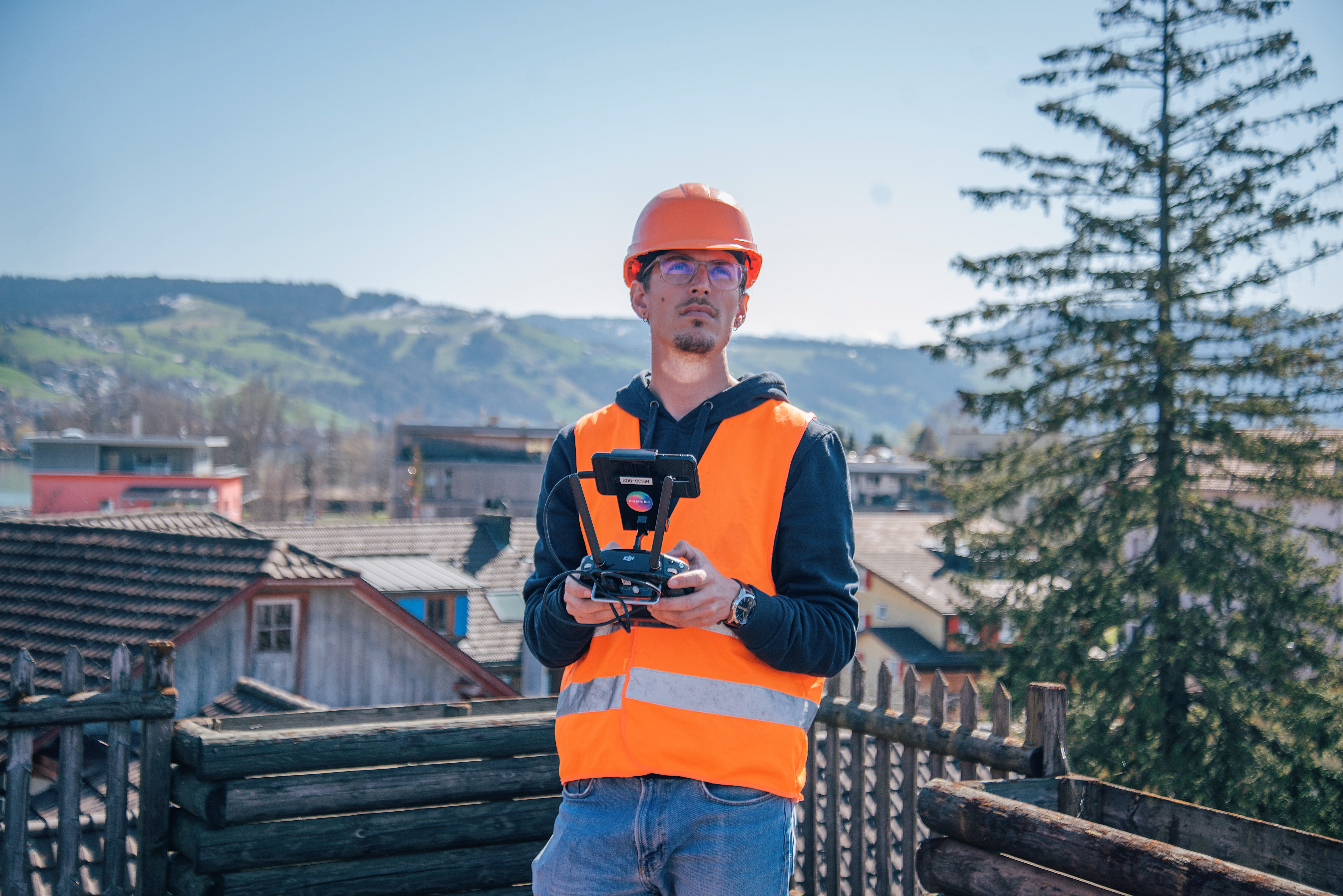 This image shows Nomoko drone pilot Mario flying a drone over a populated area in Switzerland.